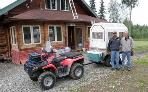 Guests with ATV and covered wagon at the homestead