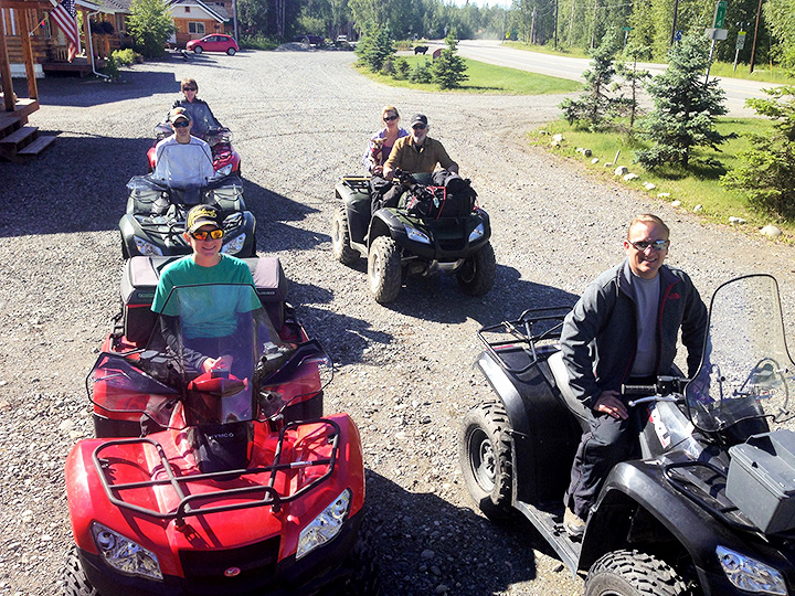 Young and older riders mount up to start an ATV ride