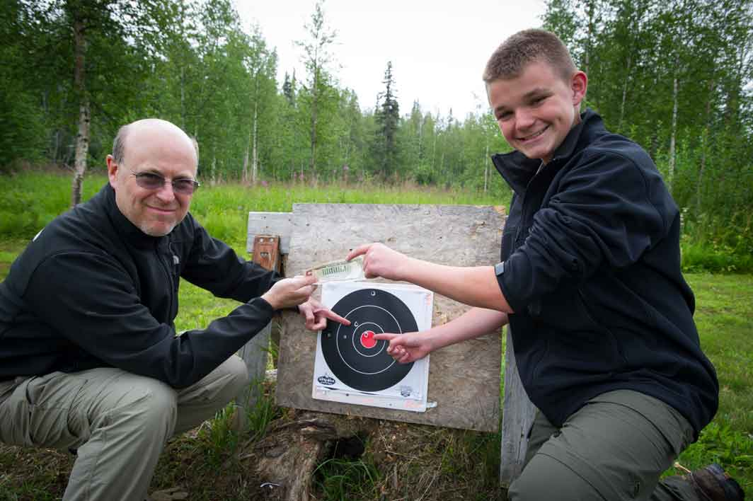 Celebrating a bullseye at the homestead target range